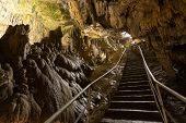 stock photo of stalagmite  - A long staircase leading to the entrance of the cave - JPG
