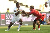 BARCELONA - SEPT, 15: Timoci Matanavou of Stade Toulousain(L) vies with USAP player during the Frenc