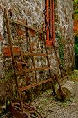 stock photo of blacksmith shop  - Exterior of Stone Blacksmith shop with antique tools - JPG