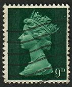 UK-CIRCA 1967:A stamp printed in UK shows image of Elizabeth II is the constitutional monarch of 16 sovereign states known as the Commonwealth realms, in green, circa 1967.