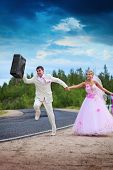 Groom With Suitcase Seeks For A Honeymoon