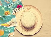 Summer postcards with straw hat on sand background