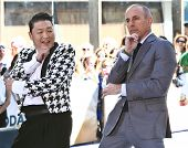 NEW YORK-MAY 3: Korean rapper Psy and Matt Lauer perform on the Today Show at Rockefeller Plaza on M