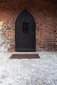 Old Wooden Door On Brick Wall