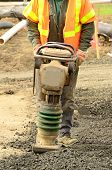 stock photo of vibration plate  - Filling the ditch with gravel new commercial development in Roseburg Oregon - JPG