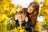 image of guess  - Portrait of little blond girl hide boys eye with guess who surprise - JPG