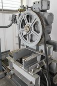 pic of pulley  - Big pulley with elevator machine on top of building - JPG