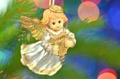 christmas decoration, figure of little angel playing the harp against bokeh background