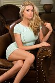stock photo of tight dress  - Beautiful tall blonde in a tight green dress - JPG