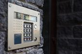 stock photo of precaution  - Video intercom on the facade of a modern building - JPG