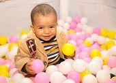 Happy Black Boy In Colored Balls
