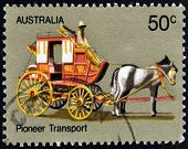 A stamp printed in Australia shows Coach Transport Australian Pioneer Life