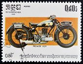 A stamp printed in Kampuchea shows a vintage Premier motorcycle
