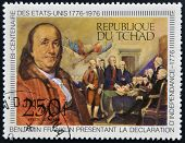 stamp shows Benjamin Franklin presenting the Declaration of Independence