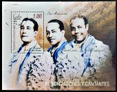 stamp dedicated to authors and singers of the Son shows the Trio Matamoros