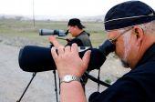 Two Ornithologists Watching Through Telescopes