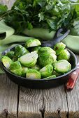 fried green brussels sprouts in the pan