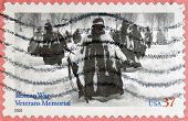 UNITED STATES OF AMERICA - CIRCA 2003: A stamp printed in USA shows American troops in Korea