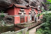 Temple Building Leaning Against A Vertical Rock In Qiyun Taoist Complex, Anhui Province, China
