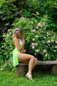 Girl In Summer Garden