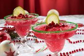 pic of pomegranate  - Two frozen pomegranate margaritas cocktails on Christmas decorated holiday table with Christmas ornaments - JPG