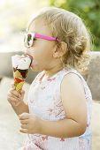 Cute Baby Girl Eating Ice Cream