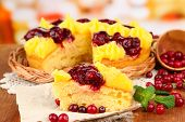 Tasty fruity homemade pie with berries, on brown wooden table