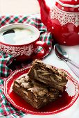 Chocolate pie and cup of coffee with festive decorations
