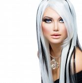 Beauty Fashion Girl black and white style. Long White Hair with Black Stripes. Smoky Eyes Makeup. Se