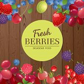 Different berries over wooden background