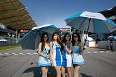 SEPANG, MALAYSIA - MAY 11, 2014: The Race Queens of the Thailand Super Series grace the the start gr