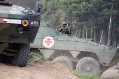 Wroclaw, Poland - May 10. 2014:  Amv Xc-360P Rosomak Armored Vehicle With Armored Medical Support On