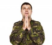 Soldier Who Makes The Gesture Of Prayer