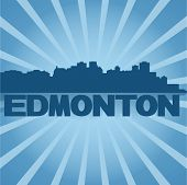 Edmonton skyline reflected with blue sunburst vector illustration