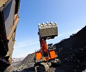 pic of iron ore  - loading of iron ore in career Excavator in railway carriages on the extracted minerals - JPG