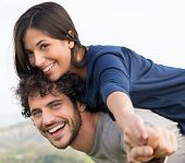 picture of piggyback ride  - Young Happy Man Giving Piggyback Ride To Smiling Woman - JPG