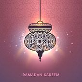 stock photo of ramadan mubarak card  - Beautiful floral decorated illuminate arabic lantern on shiny peach background - JPG