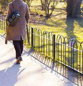 Woman walking in spring public Park