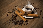 picture of coffee crop  - Cup of coffee with cinnamon on a wooden background - JPG