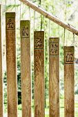 stock photo of chimes  - Wooden buddhist chimes in the garden - JPG