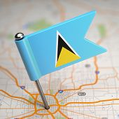 Saint Lucia Small Flag on a Map Background.