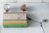 picture of emergency light  - Old emergency light is hanging on the office wall - JPG