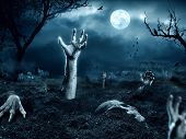 foto of cemetery  - Zombie hand coming out of his grave - JPG