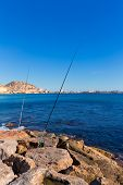 Alicante and san Juan fishing in breakwater at Spain Valencian Community