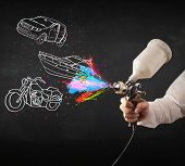 foto of air paint gun  - Man with airbrush spray paint with car - JPG
