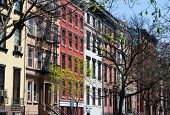 stock photo of brownstone  - Row of buildings on a block near Tompkins Square Park in New York City - JPG