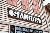 Saloon Sign On Building Facade