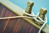 Close-up Of Rope With Tied Sea Knot On Ship Deck.