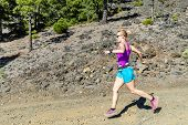 Woman Cross Country Running In Mountains