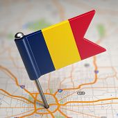 stock photo of chad  - Small Flag Republic of Chad on a Map Background with Selective Focus - JPG